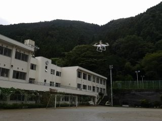 Field test of automated flight in wider area